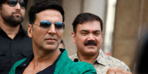FILE - In this Friday, Oct. 11, 2013 file photo, Bollywood actor Akshay Kumar shows his rings during...