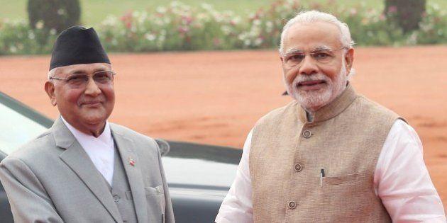 NEW DELHI - INDIA - FEBRUARY 20: Indian Prime Minister Narendra Modi (R) welcomes Nepalese Prime Minister,...