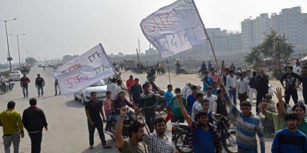 BAHADURGARH, INDIA - FEBRUARY 20: Jat community members protest demanding reservation in government services...