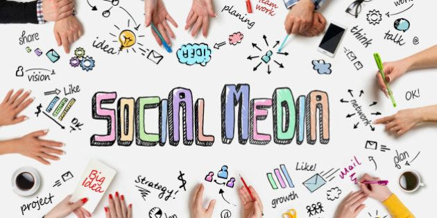 Business people group works at a table - Social Media