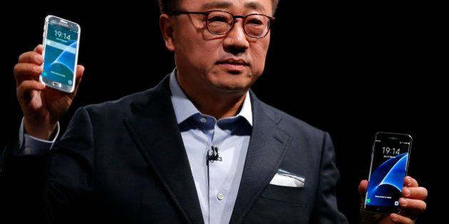 DJ Koh, President of Mobile Communications Business, Samsung Electronics, shows the new the Galaxy S7...