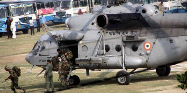 ROHTAK, INDIA - FEBRUARY 21: Army personnel get down from a helicopter at the Police Lines to handle...