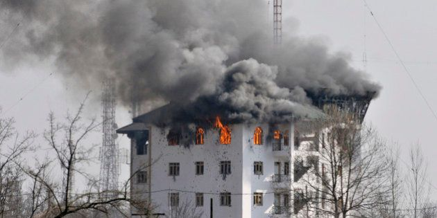 SRINAGAR, INDIA - FEBRUARY 22: Columns of smoke come out from the top floor of Entrepreneurship Development...