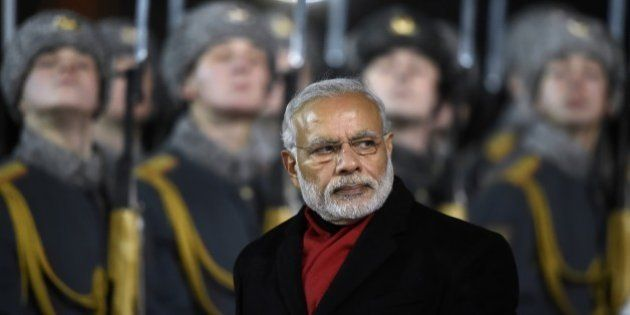 India's Prime Minister Narendra Modi reviews an honor guard during a welcoming ceremony at Moscow's Vnukovo...