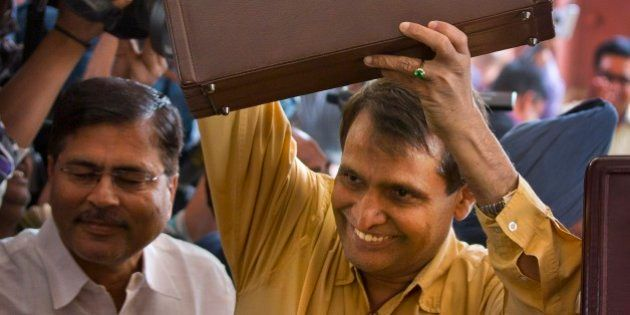 Indian Railway Minister Suresh Prabhu lifts the briefcase containing Railway budget for the year 2015-16...