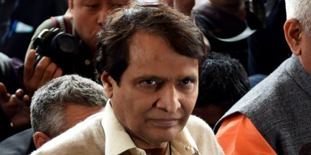 India's Railways Minister Suresh Prabhu enters Parliament House in New Delhi on February 25, 2016, ahead...