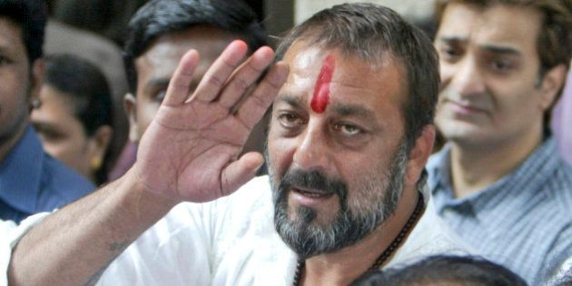 Bollywood actor Sanjay Dutt waves as he arrives at his residence in Mumbai, India, Thursday, Nov. 29,...
