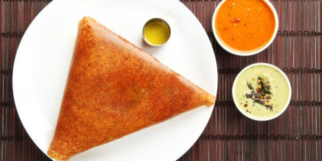 Masala dosa with different types of chutney and sambar. This is a closeup shot of one of the most famous...
