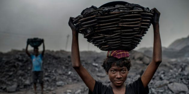 JHARIA, JHARKAND, INDIA - 2014/10/25: 16 year old MD Kahn is a worker at the Jharia coal mine.Jharia...
