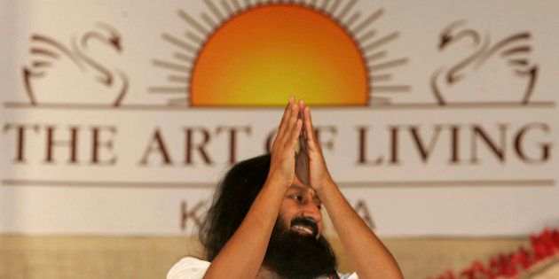 Indian spiritual guru and founder of The Art of Living Foundation Sri Sri Ravi Shankar greets followers...