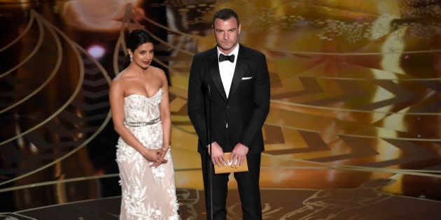 Priyanka Chopra, left, and Liev Schreiber present the award for best film editing at the Oscars on Sunday,...