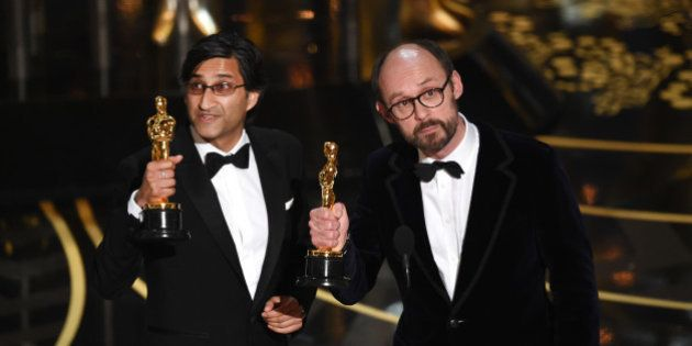 HOLLYWOOD, CA - FEBRUARY 28: Filmmakers Asif Kapadia (L) and James Gay-Rees accept the Best Documentary...