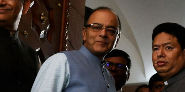 Indian Finance Minister Arun Jaitley (C) arrives at Parliament House in New Delhi on February 29, 2016, ahead of release of the General Budget. India's government is likely to lay out growth-boosting measures and overhaul its tax regime in its budget, after warning that a weak global climate was hurting Asia's third-largest economy. AFP PHOTO / Money SHARMA / AFP / MONEY SHARMA (Photo credit should read MONEY SHARMA/AFP/Getty Images)