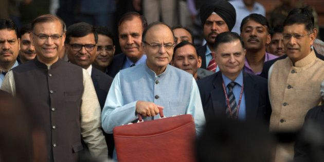 Indian Finance Minister Arun Jaitley, center, leaves for annual budget presentation at parliament in...