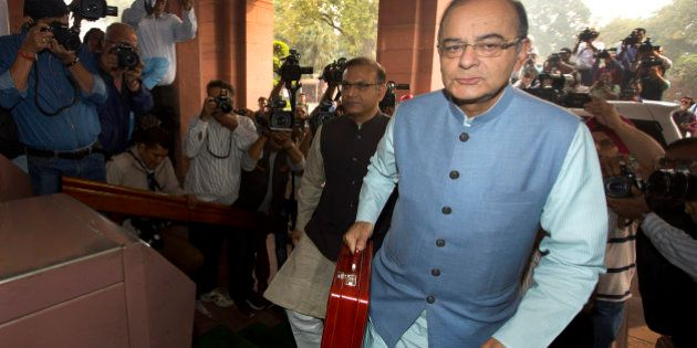 Indian Finance Minister Arun Jaitley arrives at parliament house to present federal budget 2016-17, in...