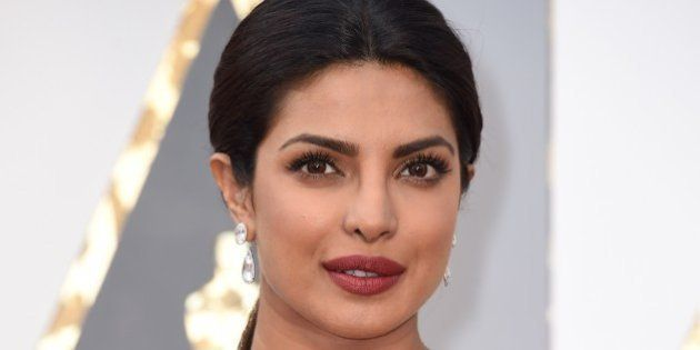 Priyanka Chopra arrives on the red carpet for the 88th Oscars on February 28, 2016 in Hollywood, California....