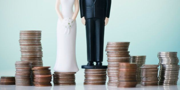 Close up of wedding cake figurines on stacks of