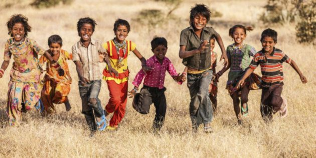 'Group of running happy Gypsy Indian children - desert village, Thar Desert, Rajasthan,