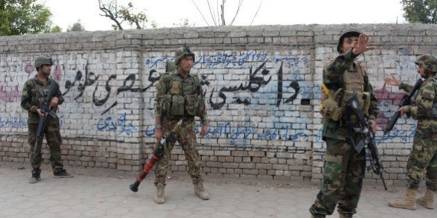 Afghan National Army (ANA) soldiers arrive at the site of an attack in front of the Indian consulate...