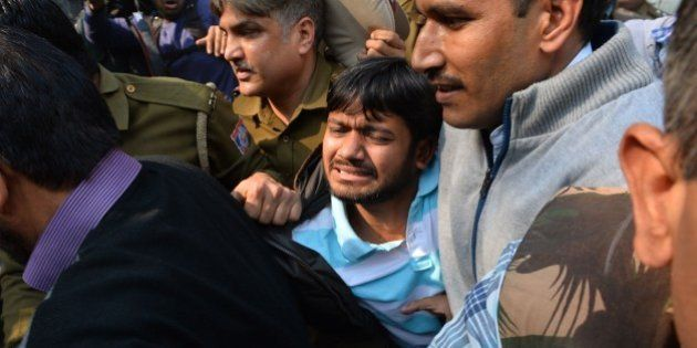 Indian student union leader Kanhaiya Kumar (C) is escorted by police into Patiala Court for a hearing...