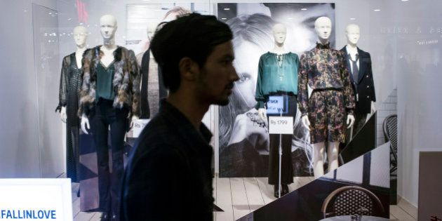 A pedestrian walks past a Hennes & Mauritz AB (H&M) window display at the Select Citywalk mall in the...