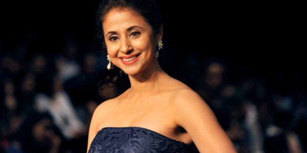 Indian Bollywood film actress Urmila Matondkar attends the Lakme Fashion Week (LFW) Winter/Festival 2013 in Mumbai on August 23, 2013. AFP PHOTO (Photo credit should read STR/AFP/Getty Images)