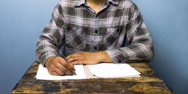 Young man writing at