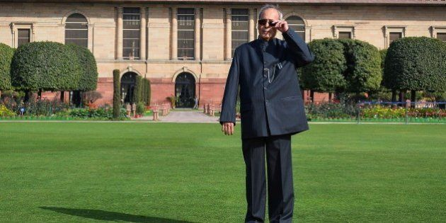 Indian President Pranab Mukherjee poses in the Mughal Gardens at the President's House in New Delhi on...