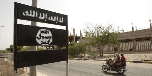 FILE - In this Friday, June 15, 2012 file photo, an al-Qaida logo is seen on a street sign in the town...