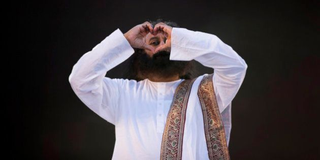 India's spiritual leader and founder of Art of Living Foundation Sri Sri Ravi Shankar looks to the crowd...