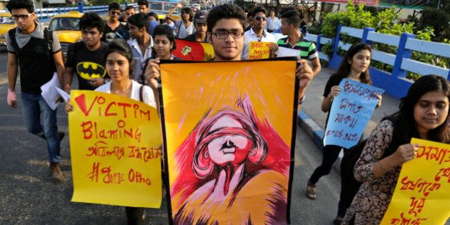 Students participate in a walk protesting violence against women in Kolkata, India, Thursday, April 2,...