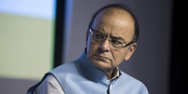 Arun Jaitley, India's finance minister, pauses during a news conference in Gurgaon, India, on Saturday,...
