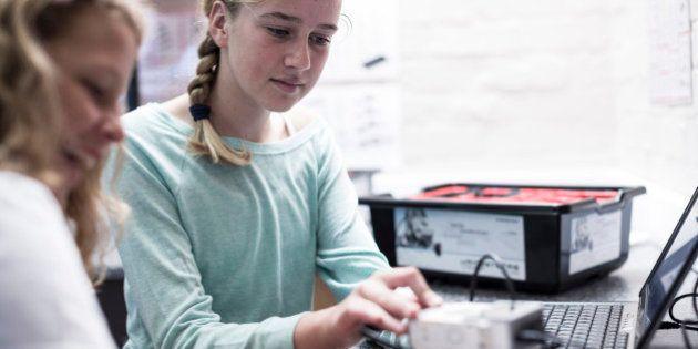 Two schoolgirls with laptop in robotics
