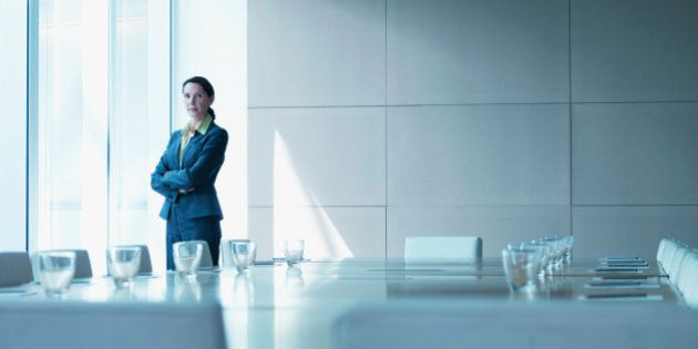 Businesswoman standing alone in conference