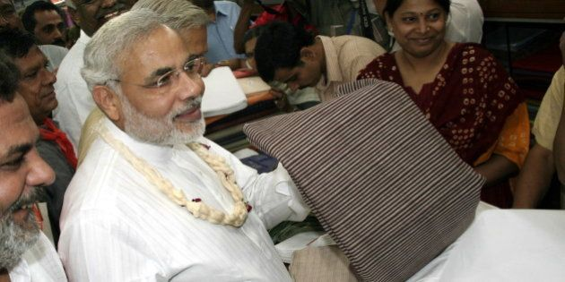 INDIA - NOVEMBER 04: Narendra Modi, Chief Minister of Gujarat purchasing the Khadi in Ahmedabad Khadi...