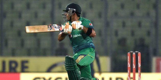Pakistan cricketer Umar Akmal plays a shot during the Asia Cup T20 cricket tournament match between Pakistan...