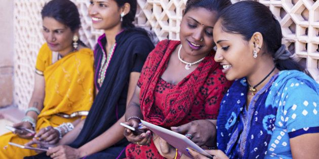 Indian women having sharing and talking with their digital