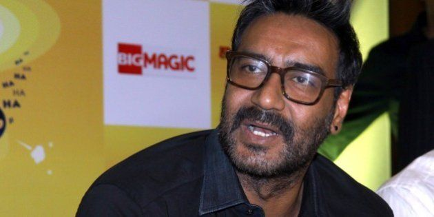 Indian Bollywood film actor, Ajay Devgn, as a brand ambassador for Hajmola Chatpata No.1, poses during...