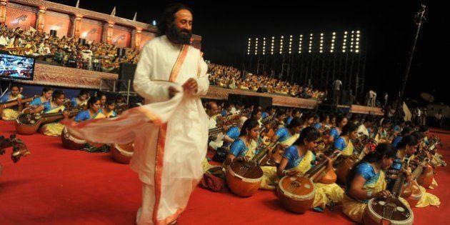 Spiritual leader and founder of Art of Living foundation Sri Sri Ravishankar (C), walks among Indian...