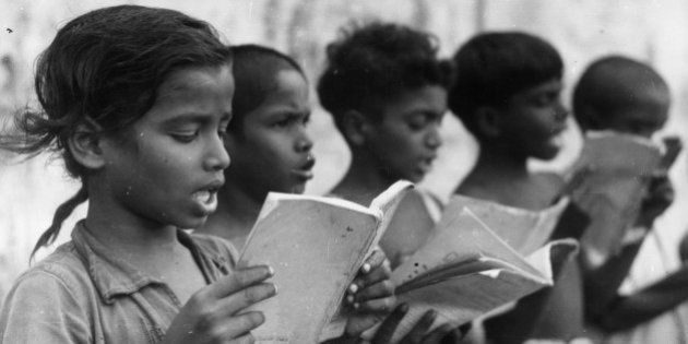 A group of Indian children singing in a central school which serves several villages around Mudichuri,