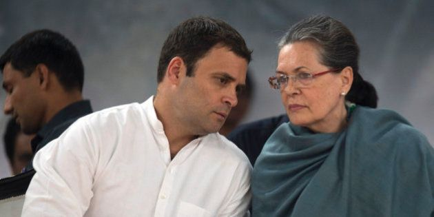 Congress party President Sonia Gandhi, right, listens to her son and party Vice President Rahul Gandhi...