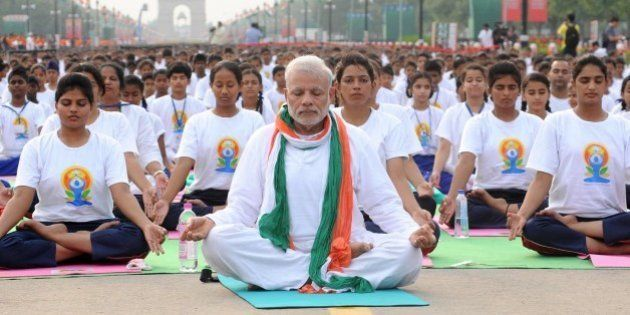 NEW, DELHI - INDIA: Indian Prime Minister Narendra Modi (C) performs yoga along with others at Rajpath...