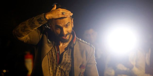 Bollywood actor Ranveer Singh dances during the trailer launch of his movie 'Bajirao Mastani' in Mumbai,...