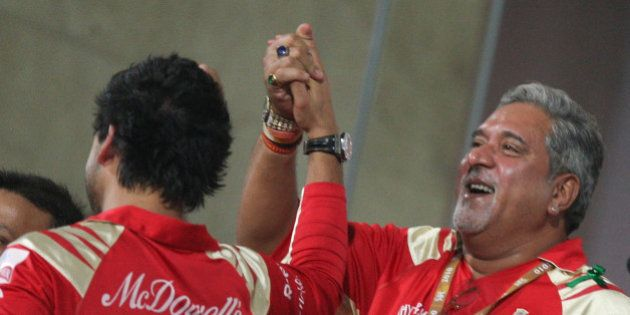 NAVI MUMBAI, INDIA - APRIL 24: Royal Challengers Bangalore owner Vijay Mallya (R) with son Siddharth...