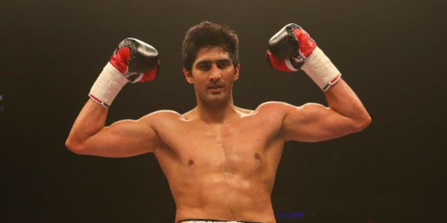 LIVERPOOL, ENGLAND - MARCH 12: Vijender Singh celebrates beating Alexander Horvath during their Middleweight...