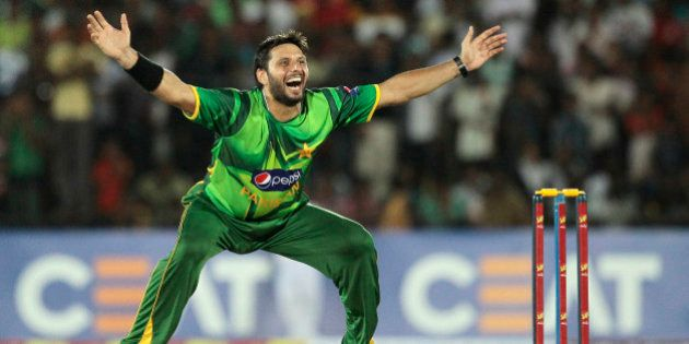 Pakistani bowler Shahid Afridi celebrates the dismissal of Sri Lankan batsman Dinesh Chandimal during...