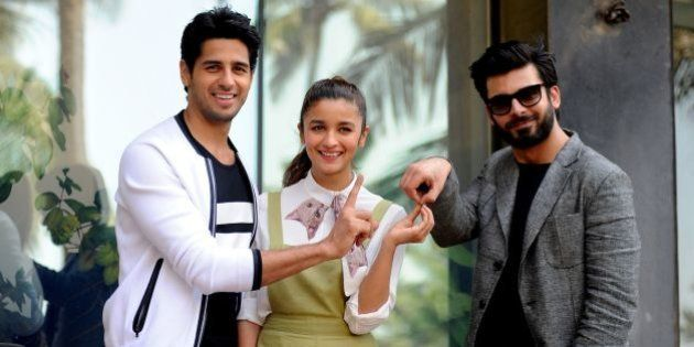 Indian Bollywood actors (L-R) Sidharth Malhotra, Alia Bhatt and Fawad Khan pose during a promotional...
