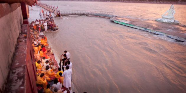 Worshippers and Yogi Sing at Sunset on Ganga The Gate At Paramartha