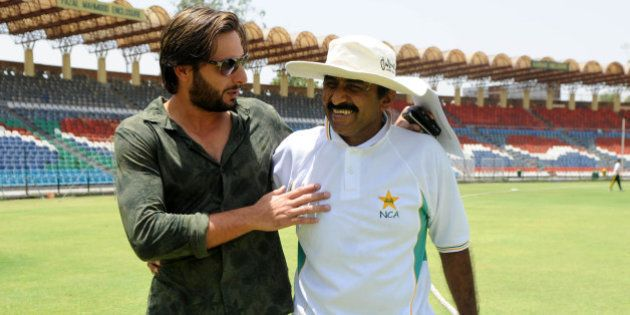 Pakistani cricket captain Shahid Afridi shares a light moment with Pakistani Cricket Board (PCB) director...
