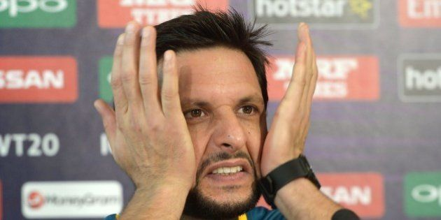 Pakistan's captain Shahid Afridi gestures as he addresses media representatives at a press conference...